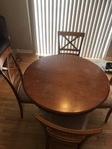 wooden dinning table with 4 chairs. in Bolingbrook, Illinois