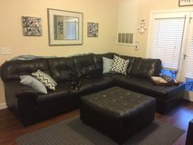 Brown faux full sectional with ottoman.  good condition. in Wilmington, North Carolina