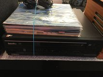 Laser disc player with 8 laser discs in Camp Lejeune, North Carolina