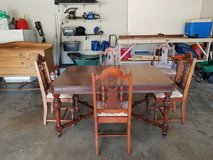 Antique solid wood dining room table with 5 chairs in Byron, Georgia
