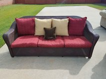 Solid wicker sofa with new custom cushions/pillows in Byron, Georgia