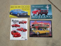 Four Metal Automotive Wall Signs in Yucca Valley, California