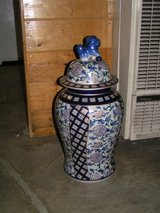 2 Vintage large ginger jars with foodog  with their front paw atop of a blue ball in Yucca Valley, California