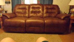 Med. Brown leather couch in Cherry Point, North Carolina
