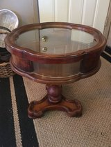 """Small round table glass sides and top. Top dose open.  20 1/2.   Across. 22""""tall in Kingwood, Texas"""