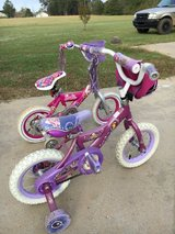 2 girls 12 inch bikes with training wheels in Warner Robins, Georgia