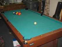 Mizerak brand pool table with 7 cues with pro cues in Camp Pendleton, California