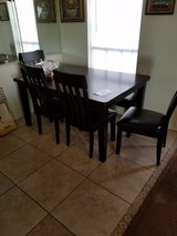 Dining room table by Ashley in Pasadena, Texas