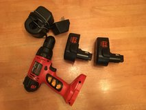 Black & Decker 14.4 volt cordless drill + 2 battery packs and charger in Glendale Heights, Illinois