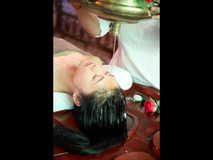 Traditional Indian massage(oil pouring) in Okinawa, Japan