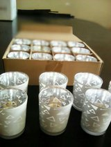 19 votive holders total all are never used i have 12 scented candles (new) in Naperville, Illinois
