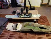 Salomon Snowboard with boots in Vacaville, California
