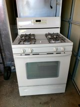 Whirlpool Refrigerator with Ice maker  21 Cu Ft. + Kenmore stove With manuals beige color in Plainfield, Illinois