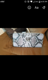 Coach snake print wallet in The Woodlands, Texas