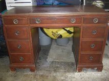 Desk with leather top and a little chair in Bolingbrook, Illinois