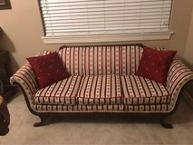 Red fancy sofa couch in Kingwood, Texas