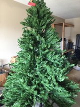 Pre-lit 7 foot Christmas tree in good condition in Macon, Georgia