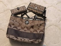 Brown Coach bag with two wallets in Camp Lejeune, North Carolina