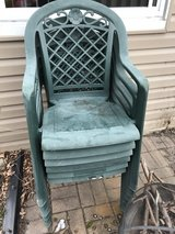 6 green plastic patio chairs in Glendale Heights, Illinois