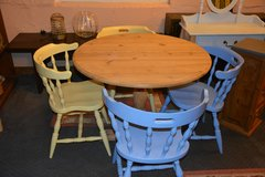 Circular pine Dinning table and 4 painted captain chairs in Lakenheath, UK