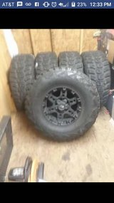 Adventure tires m/t 35/12.50 r17 on KO black rims in Fort Drum, New York
