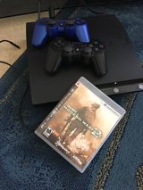 Play Station 3, 2 controllers and a game in Travis AFB, California