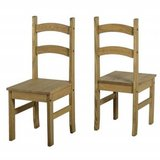 Two Mexican pine dining table chairs in Lakenheath, UK