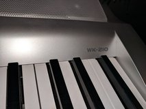 Casio WK-210 Keyboard and stand in Kingwood, Texas