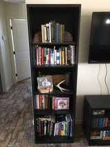 Black IKEA bookcases, TV stand, and coffee table in Yucca Valley, California