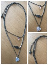 Silver & matte gold three strand heart & love necklace in Perry, Georgia