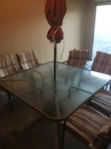 Patio table with umbrella and chairs in Fort Carson, Colorado