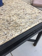 Rod iron granite top patio table in 29 Palms, California