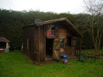large two storey wooden playhouse in Lakenheath, UK