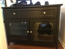 Black TV Stand with Glass Doors and Storage Drawer in Schaumburg, Illinois