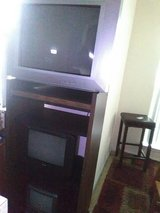 Tv and stands in Pasadena, Texas