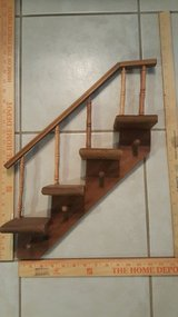 Stair shelf with pegs to hang small items in Kingwood, Texas