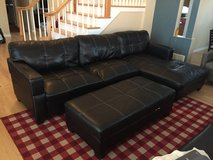 Faux Leather Sectional with storage ottoman in Aurora, Illinois