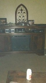 Ashley TV stand. with electric .fireplace insert in Fort Polk, Louisiana