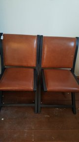 Leather upolstered chairs in Elgin, Illinois