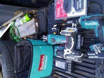 Makita cordless  screwgun and router and drill with charger 4 batteries and carrying case in Beaufort, South Carolina