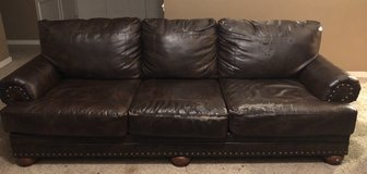 Brown bonded leather sofa in Perry, Georgia