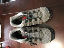 Solomon hiking shoes size 4 in Fort Campbell, Kentucky