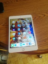 LIKE NEW SILVER IPAD 4 MINI UNLOCKED AND WIFI 16GB COMES WITH CHARGER AND BRAND NEW GRIFFIN DEFE... in Fort Campbell, Kentucky