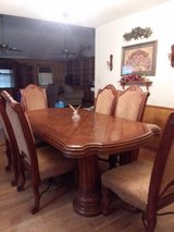 Beautiful solid dining table and chairs in Kingwood, Texas