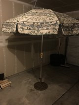 Tilting Patio Umbrella with cast iron stand in Fort Lewis, Washington