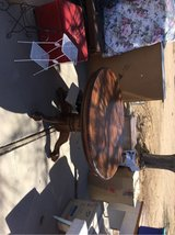 Very good condition/oak kitchen table w/ leaf that extends table and large claw feet. in Yucca Valley, California