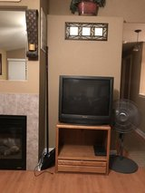 Panasonic tv with stand in Fort Lewis, Washington