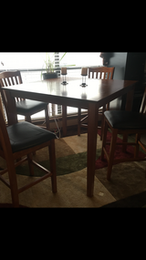 Height top table set leather in a great condition for $300 in Lawton, Oklahoma