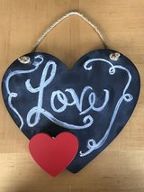 "Chalkboard ""love"" heart shaped sign in Warner Robins, Georgia"