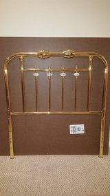 Brass Twin Headboard with Floral Ceramic Toppers in Joliet, Illinois